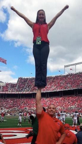 Ohio State cheer coach Ben Schreiber stunting at tOSU Alumni Day.