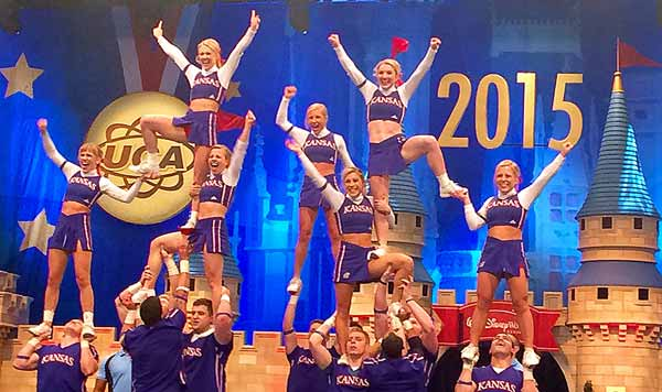Photo of KU celebrating in the last pyramid after our zero-deduction routine at 2015 UCA College Nationals.